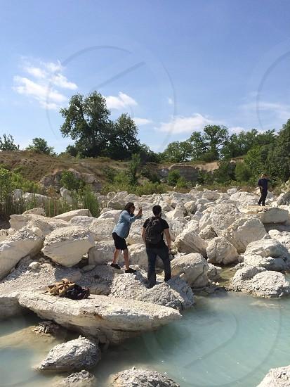 white boulders on lake photo