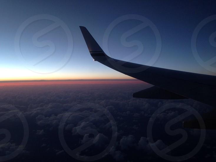 Kauai HI Airplane Sunset 38000 feet Pacific Ocean CloudsWing photo