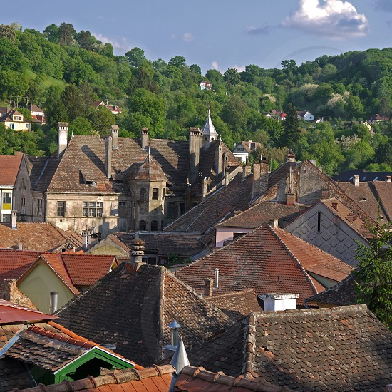 Sighisoara old town. Old houses in Romania. Ancient architecture in Transylvania. Roofs of the historic city in Romania photo