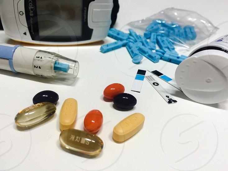 Blood testingmonitor kitblood checker blood sugar controldiabetes controlmedicinestablets photo