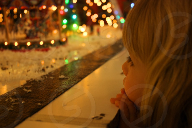 Little girl looking in awe at a Christmas display photo
