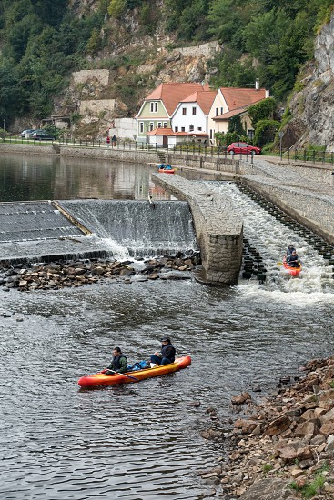 People Canoeing down the Vlatava River to Krumlov photo