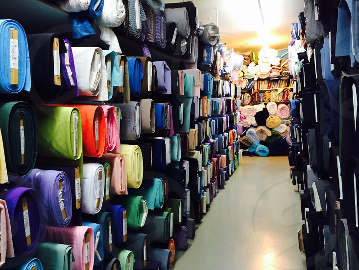 assorted rolled textile inside the store photo