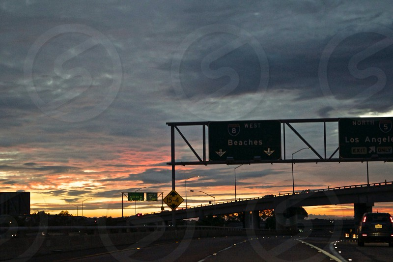 Beach bound road trip west coast Southern California San Diego sunset overpass photo