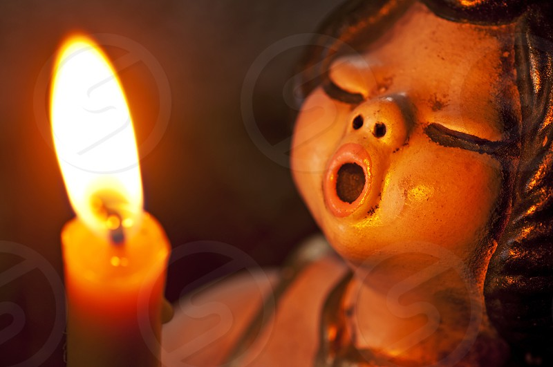 singing angel with candle light photo