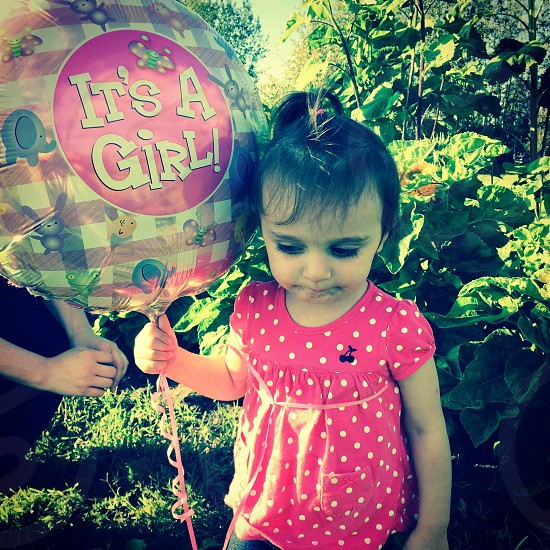 It's a girl! Gonna be a big sister.  photo