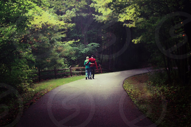 woman and man walking on road photo