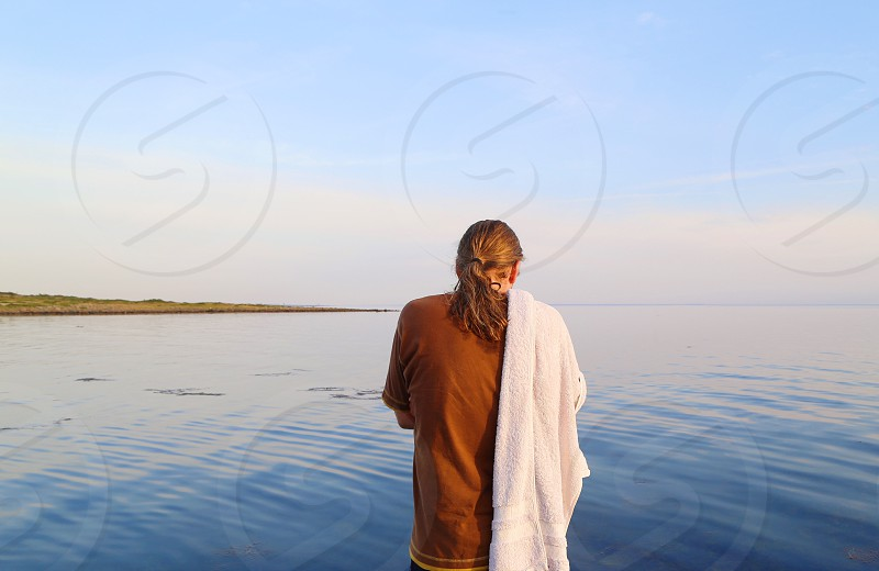 Swimmer sea water person portrait  morning from behind silence man tranquil  tranquility thoughtful  photo