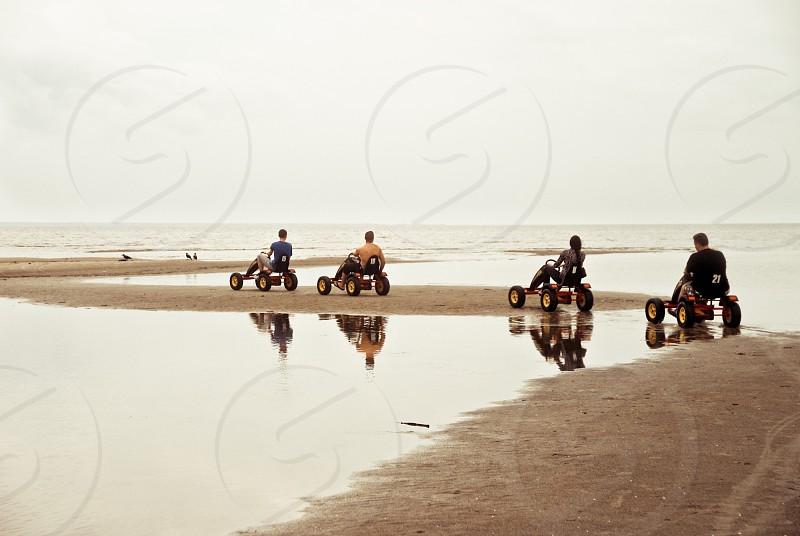 Weekend ride people activity sea reflection water sand beach seashore photo