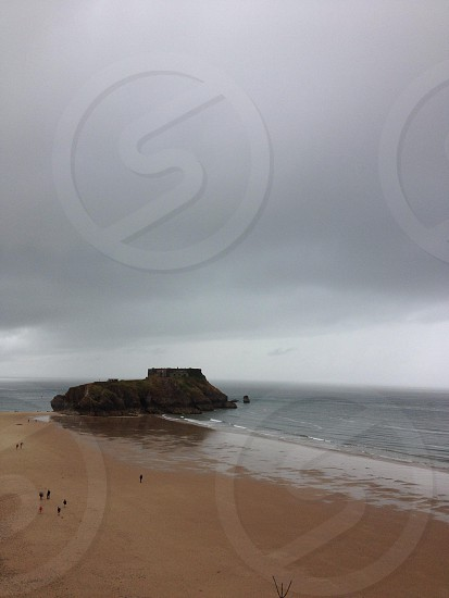 Gray Clouds Over Beach and Sand photo