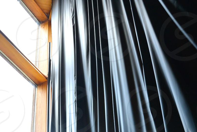 black window curtain photo