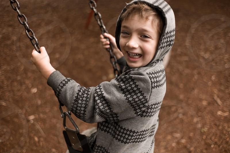 child swing smile playground earth chain hoodie bokeh photo