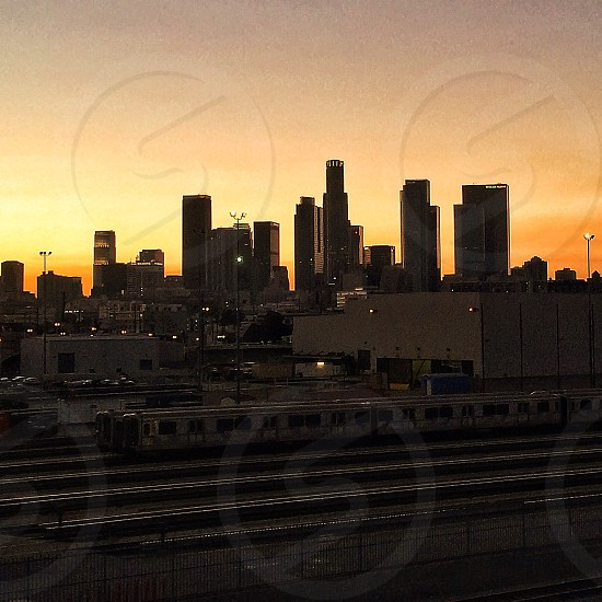 sunset over buildings photo