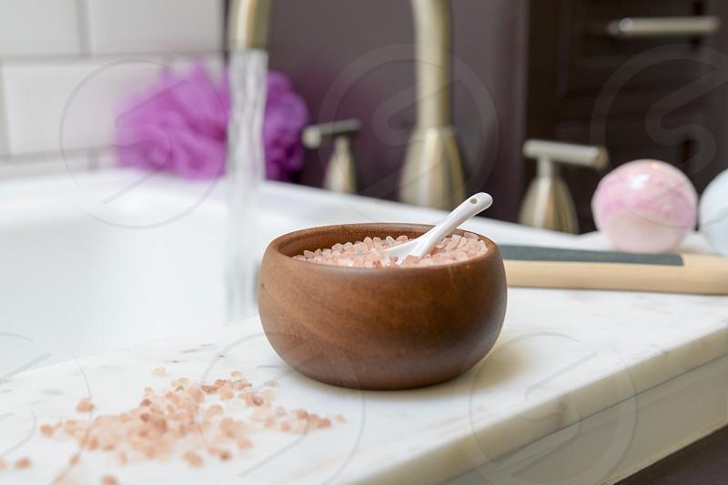 A sea salt bath scrub ready for a luxurious soak photo