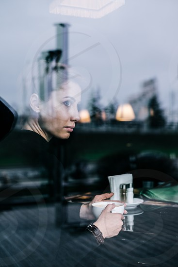 Woman drinking coffee in the restaurant photo
