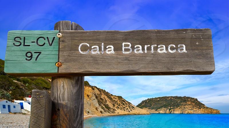 Cala Barraca beach sign in Xabia Javea photomount on background Alicante Spain photo