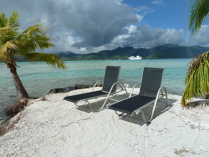 Tahiti water cruise ship 2 chairs on the beach photo