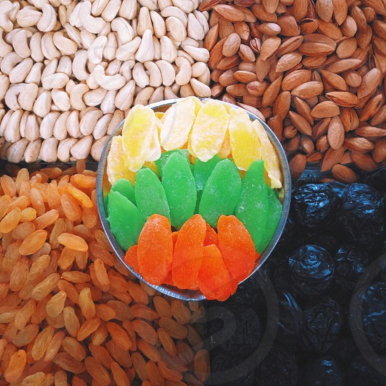 assorted nuts and candies on display photo