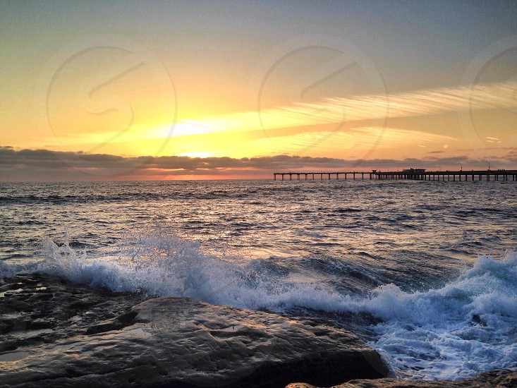 sea wave during sunset photo
