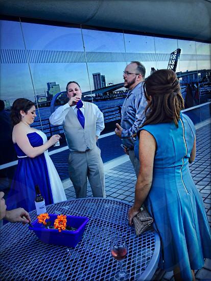 4 people talking photo