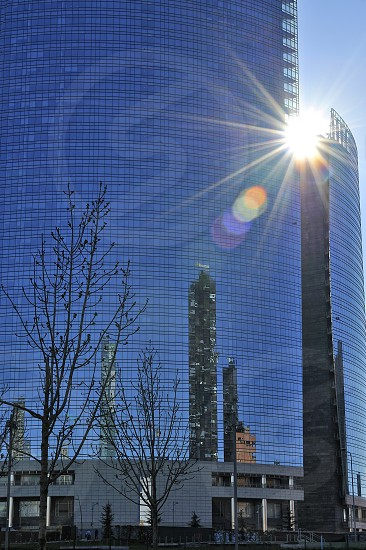 Sun reflection on Porta Nuova skyscraper Milano Italy photo