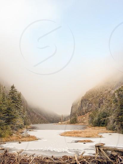 Avalanche lake Adirondacks. High peaks 46er.  Fog clouds winter.  Beaver dam trap dike Colden. Upstate photo