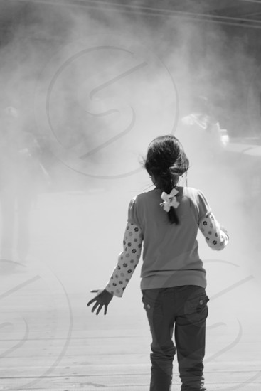 Girl running through the fog photo
