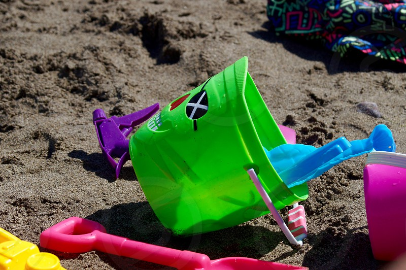 bucket and spade sand beach holiday sun photo