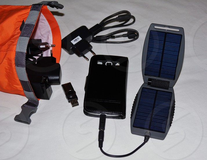 Electronics phone accessories charger usb connectors cables screen solar panels white black orange gray dark blue. photo