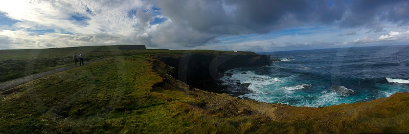 Ireland; cliffs; Kilkee; water; sea; green; grass; couple  photo