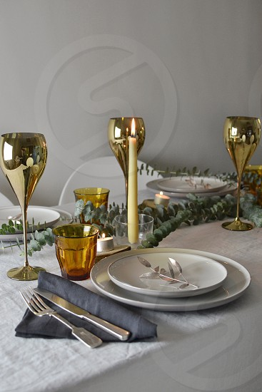 Christmas thanksgiving table setting table styling crockery dining eating gold wine glasses festive family  photo