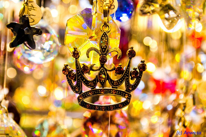 gold-colored crown pendant photo