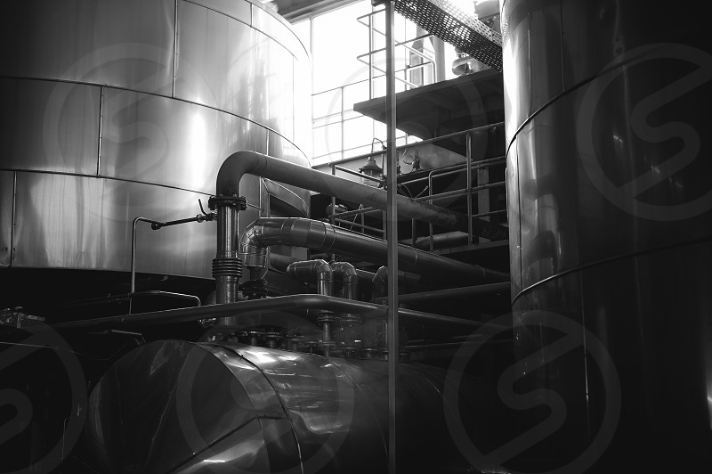 Beer manufacture line. Equipment for staged production bottling of Finished food products. Metal structures pipes and tanks at enterprise factory. Special equipment inside within industrial premises photo