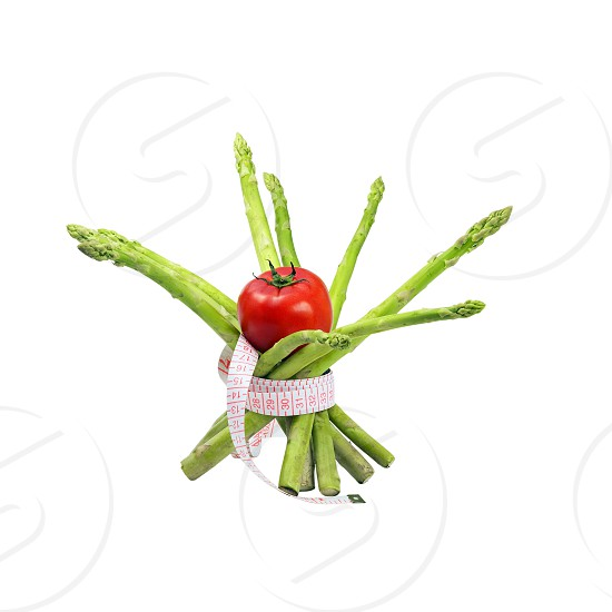 asparagus and tomato with a meter around isolated on white background photo