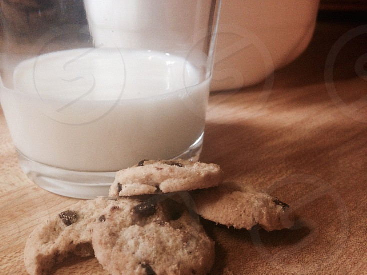 chocolate chip cookie beside glass of milk photo