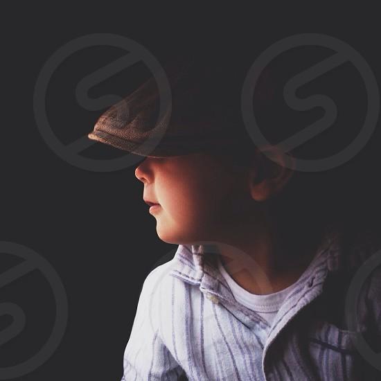 boy's white and black dhirt photo