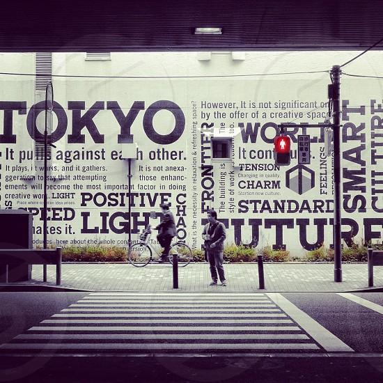 man standing on street photo