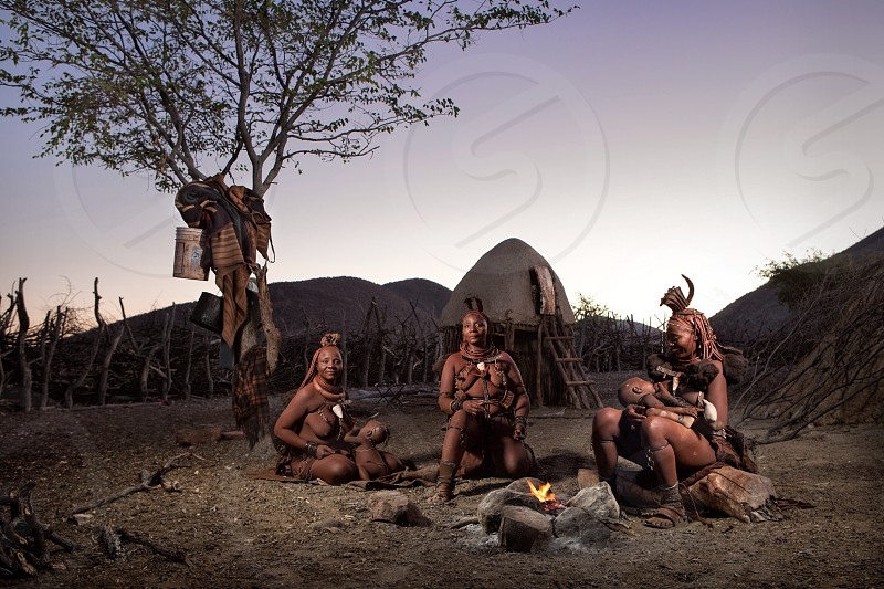 Himba women around a fire of an evening. photo