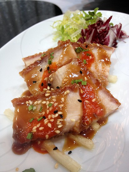 Fish with red sauce photo