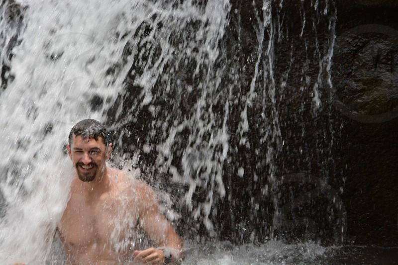 man on water during daytime photo