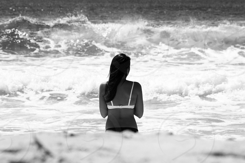view of woman standing by the beach photo