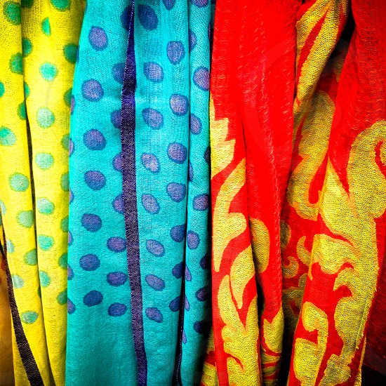 Three brightly coloured scarves photo