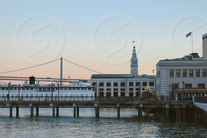 San Francisco Ferry Building and Embarcadero pier urban landscape on the waterfront at sunset photo
