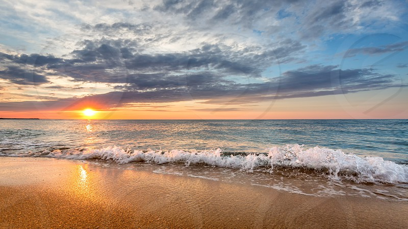 Beautiful sunrise at the beach photo