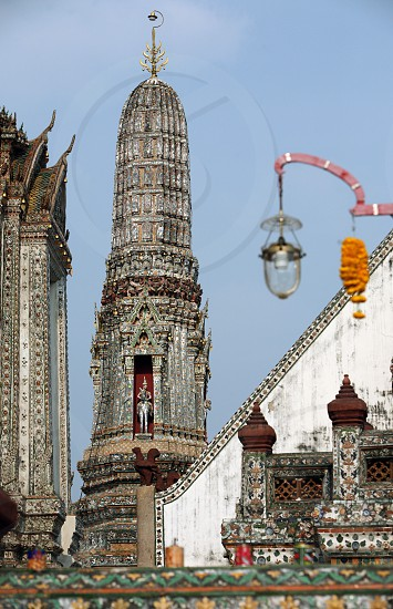 the wat Arun Temple at the Mae Nam Chao Phraya river in the city of Bangkok in Thailand in Suedostasien. photo
