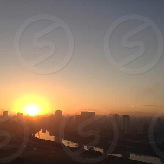 view of orange sunset in the city photo