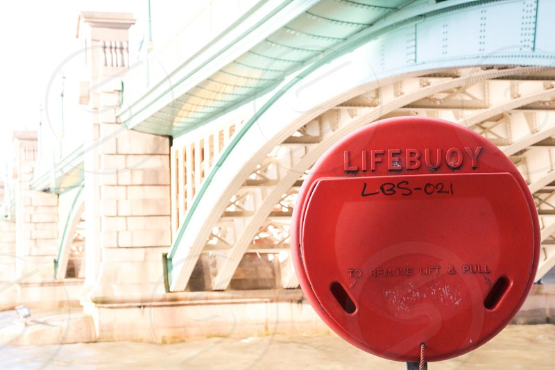 Bridge water construction red lifebuoy saving saver save river Thames  red colorful  constructions architecture photo