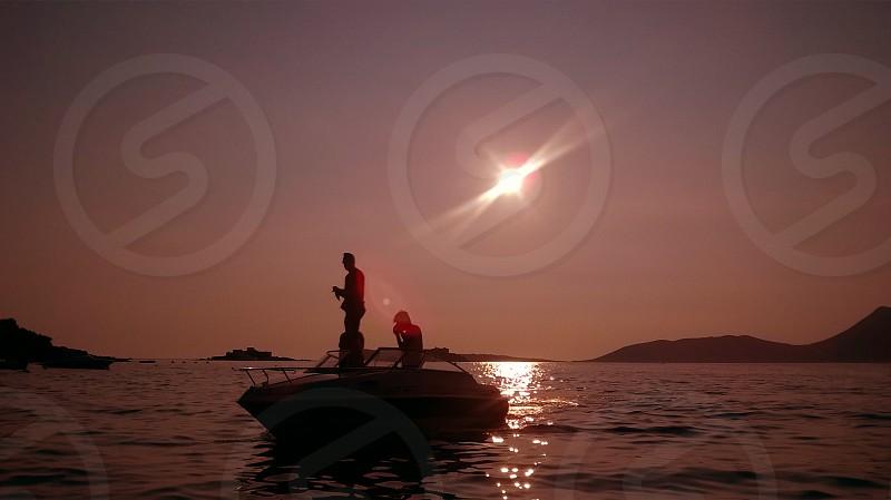 Montenegro Adriatic sea Lustica peninsula Boka Kotorska beach Mirista boat approaching photo