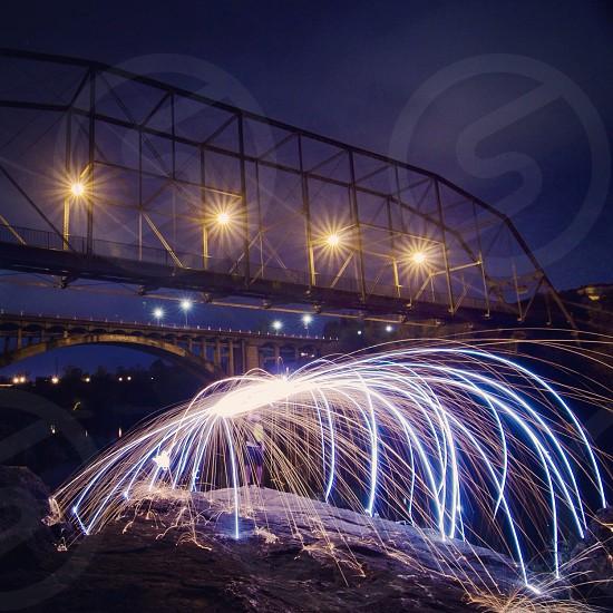 metal bridgeway with lighted lamp photo