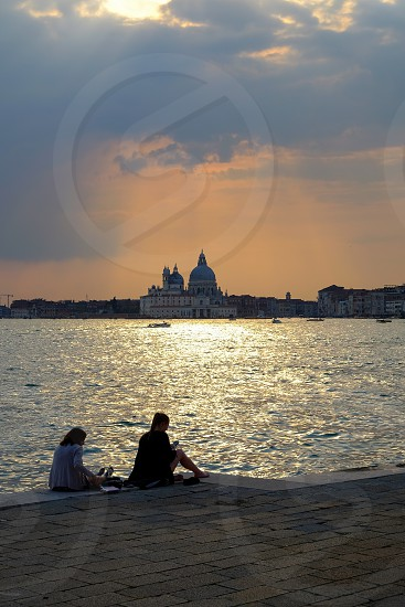 couple of ladys watching the sunset in Venice Italy photo
